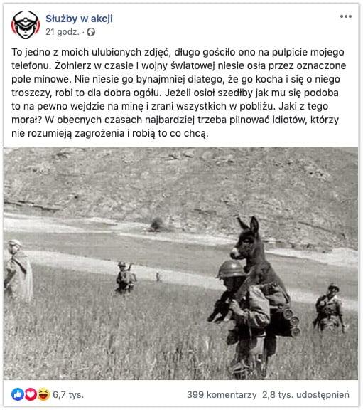żołnierz niesie osła