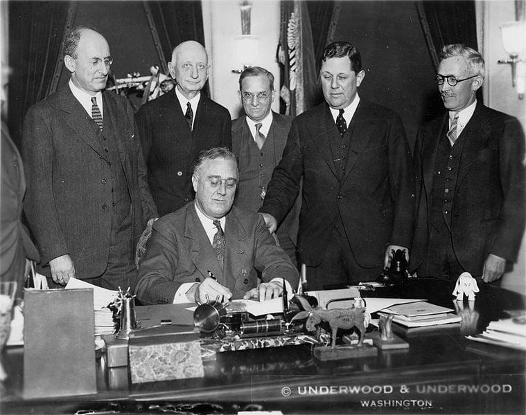 President Franklin D. Roosevelt signs the Gold Bill on January 30,1934
